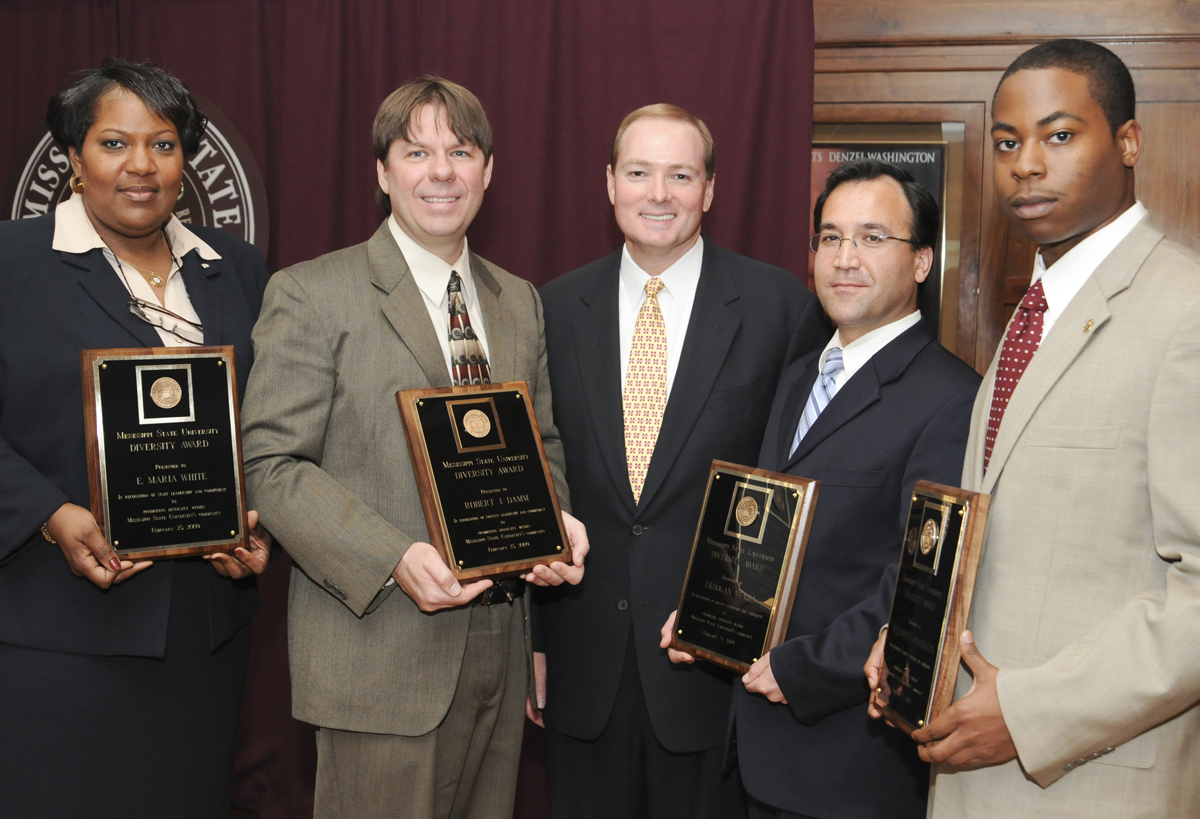 MSU President Mark Keenum (center) congratulates 2009 Diversity Award winners (from left) Maria White, Robert Damm, Erdogan Memili, and Alexander Washington.