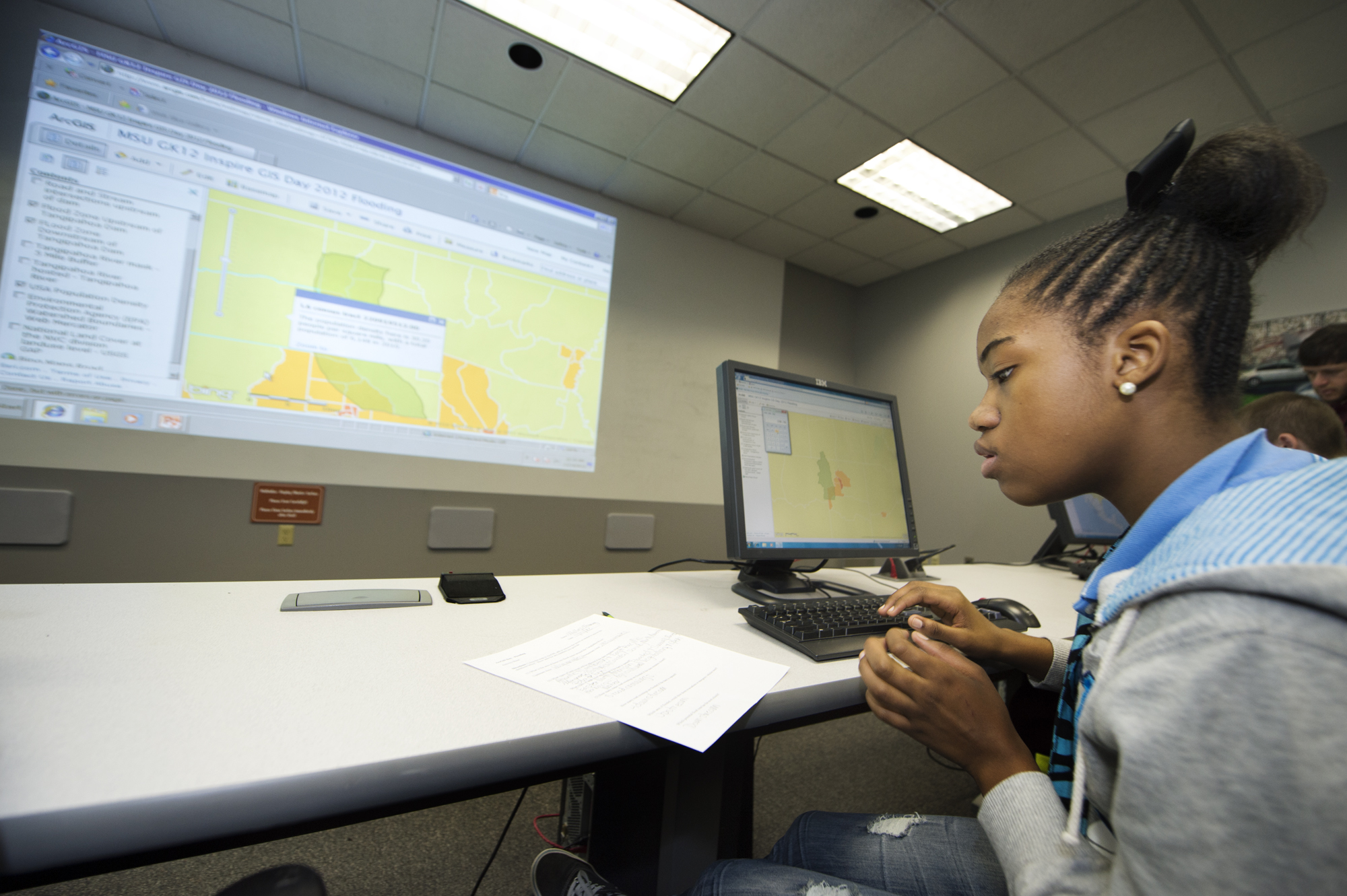 Columbus Middle School eighth-grader Mallory Manning uses geographic information systems to track a hurricane's trajectory in a computer lab at Mississippi State University, part of the institution's celebration of GIS Day.