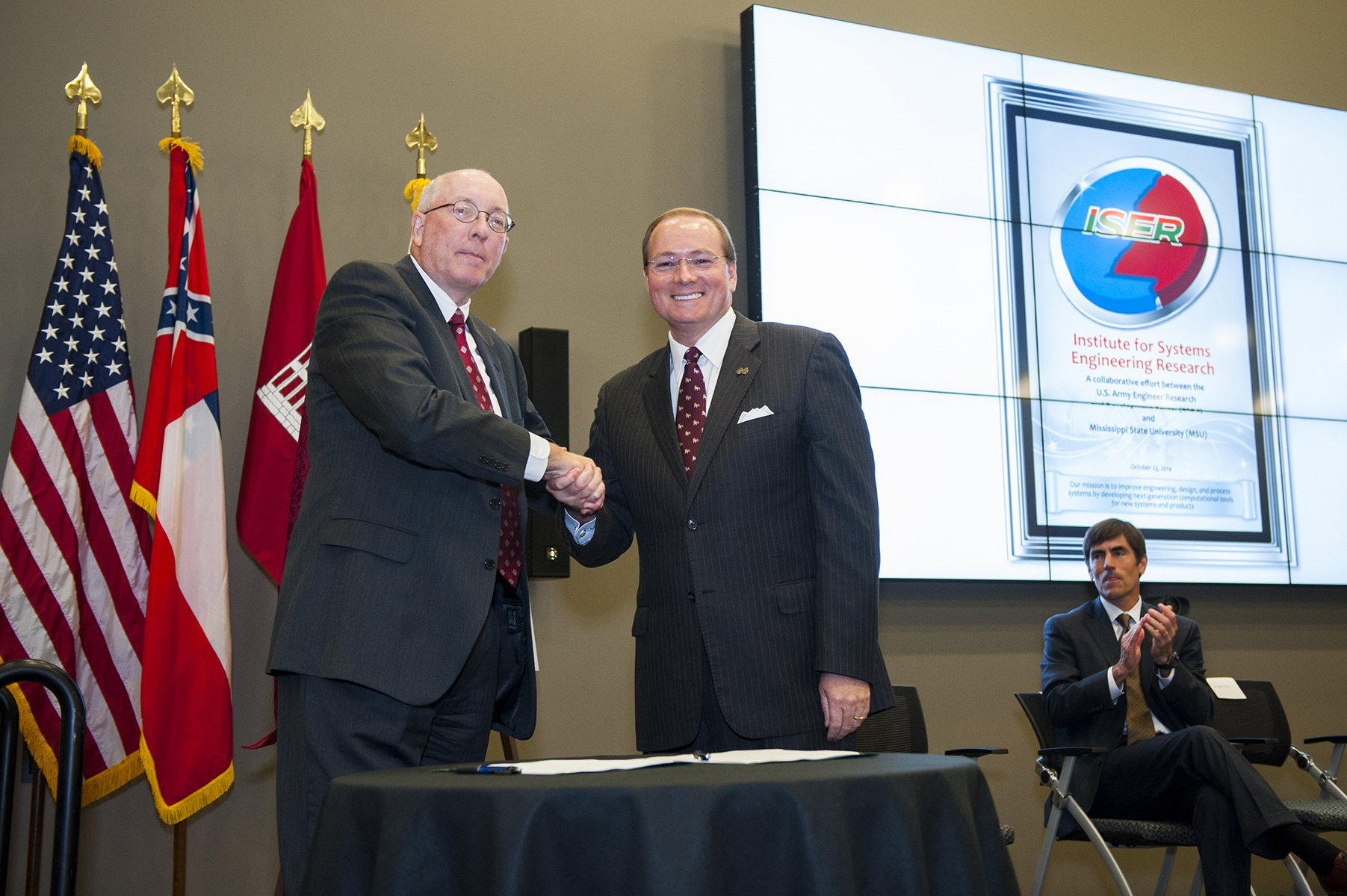 Jeffery P. Holland (l-r), director of the U.S. Army's Engineer Research and Development Center in Vicksburg, and MSU President Mark E. Keenum celebrate the signing of an agreement establishing the Institute for Systems Engineering Research Thursday afternoon [Oct. 23]. The collaborative research initiative will create a hub to develop advanced systems that enhance existing industries, attract new jobs and bolster national defense capabilities.