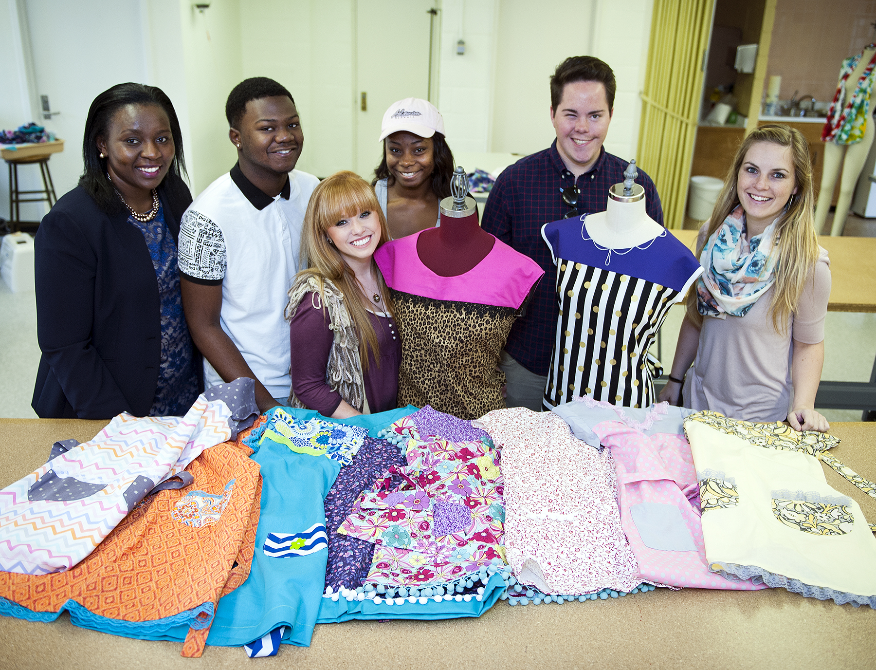 Apparel design instructor Caroline Kobia, (l-r) is pictured with some of her apparel design students who collaborated for Project Runway Kids, including De'Marquis Weaver of Greenwood, Katie Brown of Olive Branch, Octavia Lewis of Richland, Jesse Newton of Eupora, and Katja Walter of Germany.