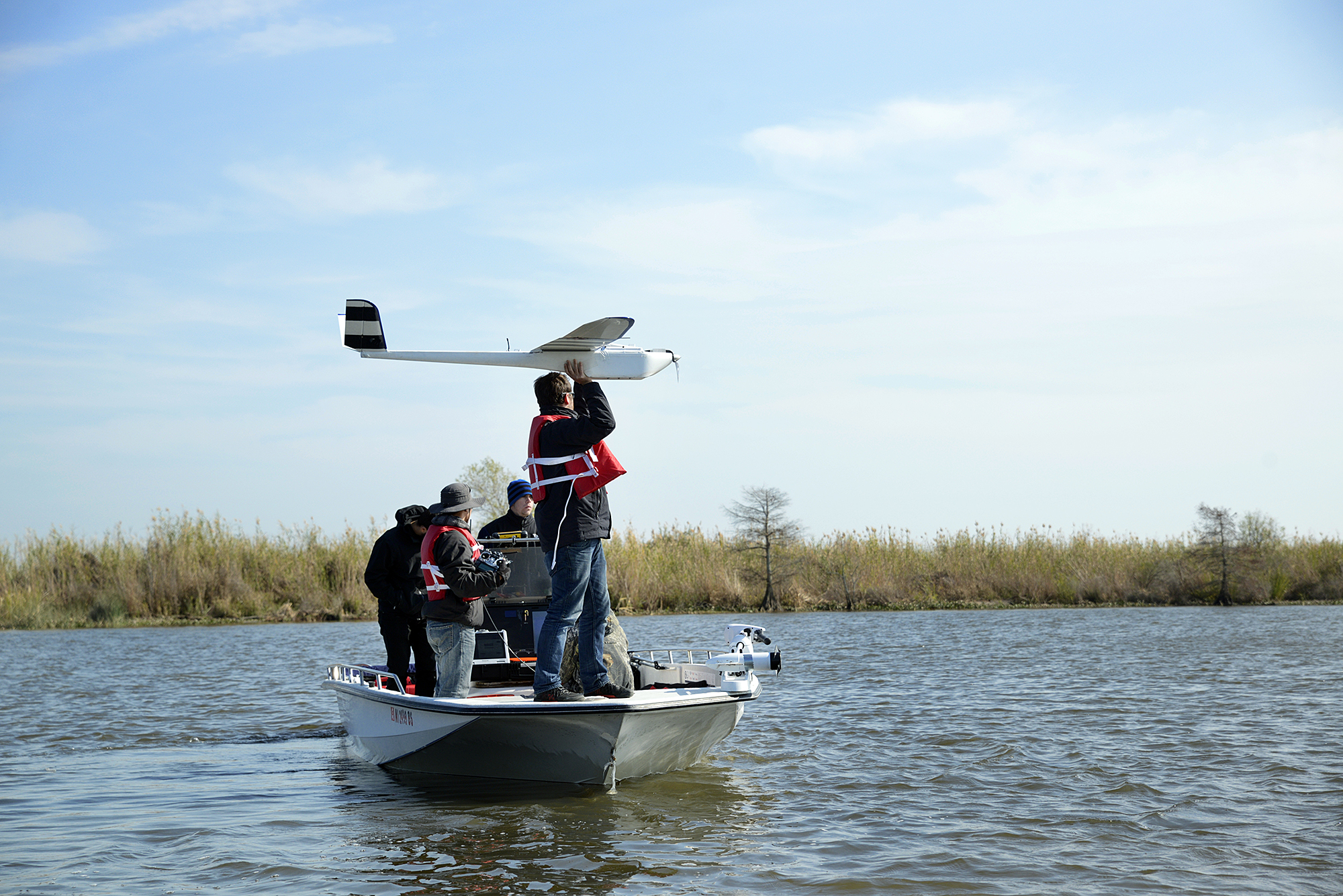 An unmanned aerial vehicle is prepared for launch on Thursday [Dec. 18] in St. Tammany Parish, Louisiana. Researchers with Mississippi State and NOAA are mapping sections of the Pearl River with the UAV to better understand where and how much water flows through the area and the impact it can have on local communities when hurricanes and other tropical weather systems develop.