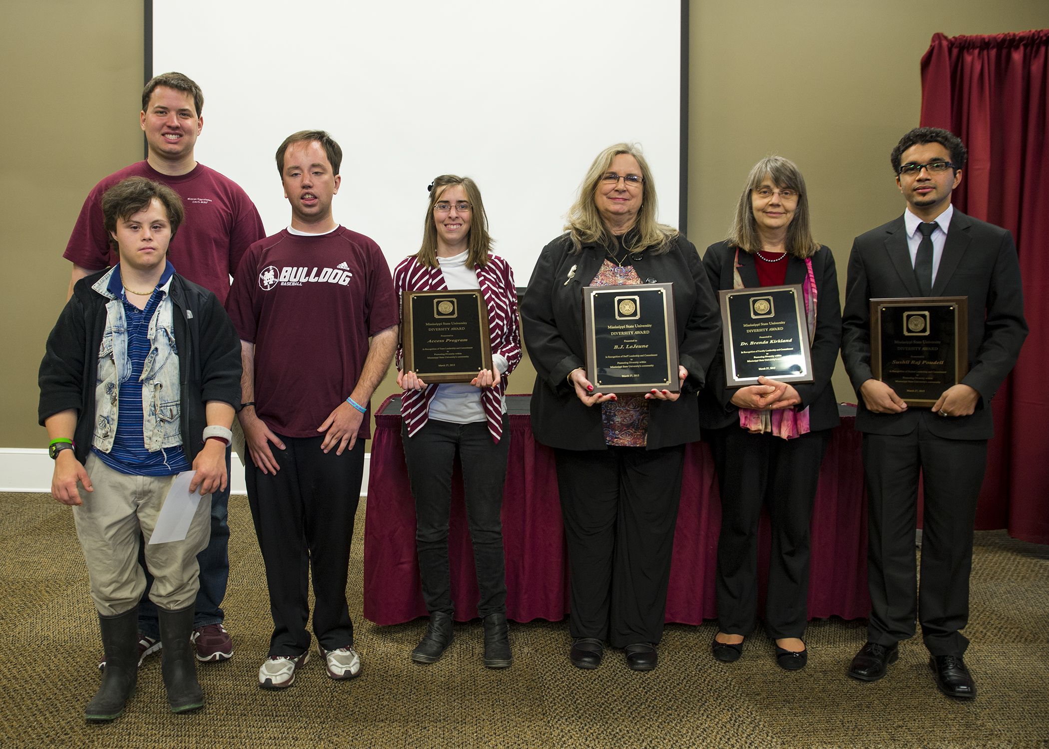 Accepting 2015 Diversity Awards from the MSU President's Commission on the Status of Minorities are, from left, Joe Silvera (front), Daniel Mooney, Wade Sims, and Amanda Byrd, for the campus' ACCESS program; staff member B.J. LeJeune; faculty member Brenda Kirkland; and doctoral student Sushil Raj Poudel.