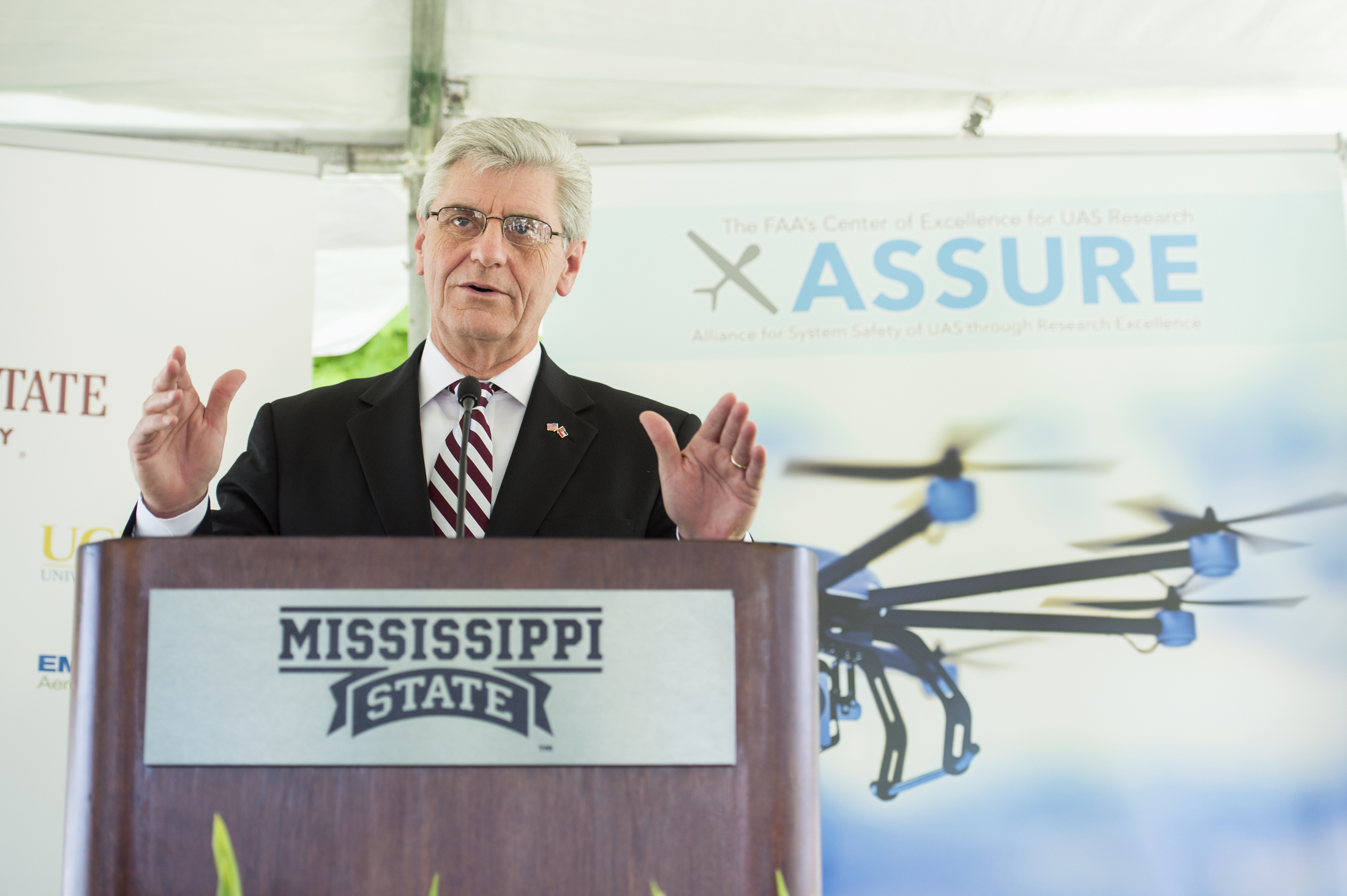 Gov. Phil Bryant speaks at Mississippi State University Friday [June 5] during a campus press conference about the Federal Aviation Administration designating the university as the National Center of Excellence for Unmanned Aircraft Systems. Bryant lauded MSU's leadership and the positive impact that ongoing research and development will have on the state's economy. Bryant said research at MSU has led the world in aerospace, automobile manufacturing and agribusiness.